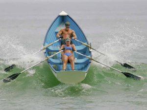 Michael Dunn and Jennifer Welc burst through a LBI wave - Jim O'Connor