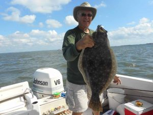 Tom Seiz with his 6.5 lb. fluke - Bill Piotrowski